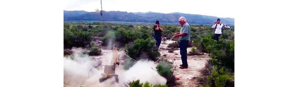 KEN ROSE sets off a charge similar to an eight gauge shotgun blast, to release energy waves into the ground to help with the underground mapping of the area. Modoc County Record