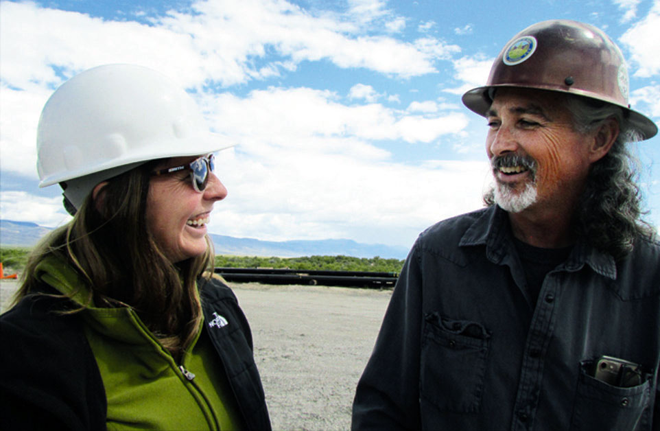 LISA SAFFORD-KUSCO is president of Blackrock Geoscience and an officer in Warner Mountain Energy Corporation compares notes with Curtis Rose of WME. Modoc County Record